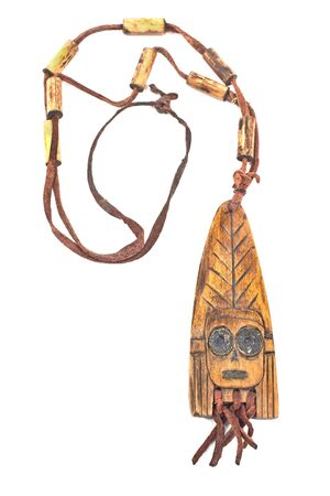 fretwork: Wooden necklace with pendant of african woman isolated on white