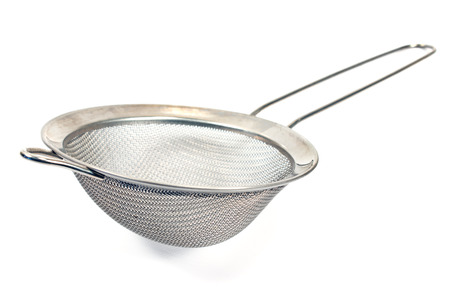 a colander: Colander isolated on a white Stock Photo