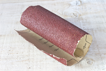 emery paper: Emery paper - sandpaper on white wooden board