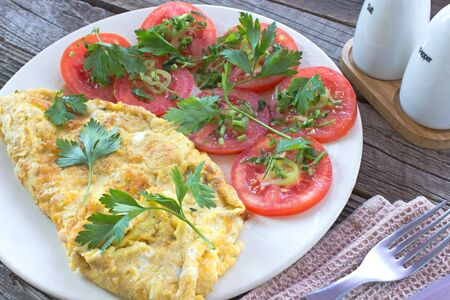 omlet: Omelette with vegetables on wooden background Stock Photo