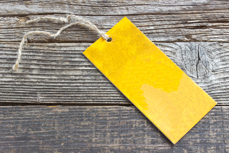 blank tag: Blank price tag on wooden background Stock Photo