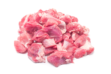 chops: Pile of chopped  pork meat for goulash isolated on white