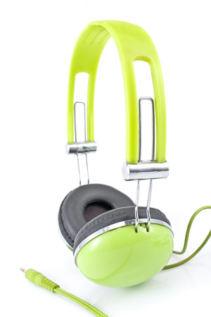 Green headphones isolated on white