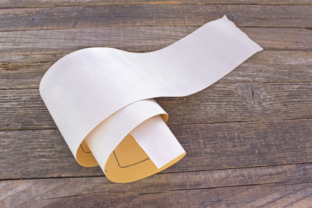 emery paper: Emery paper - sandpaper on old wooden board Stock Photo