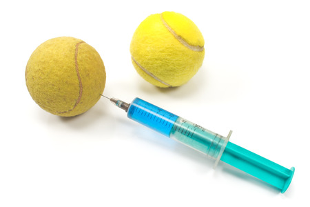 steroid: Tennis  balls with a syringe isolated on white Stock Photo
