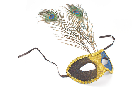 gilt head: Carnival mask with peacock feathers isolated on white