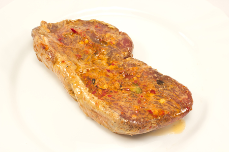 marinade: Raw beef steak with marinade in white plate Stock Photo
