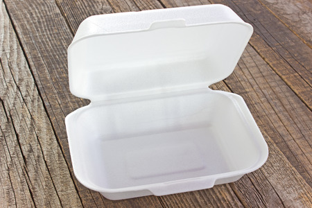 Styrofoam box for food on wooden table Stock Photo