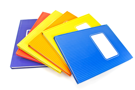 Colorful notebooks isolated on white background Stock Photo