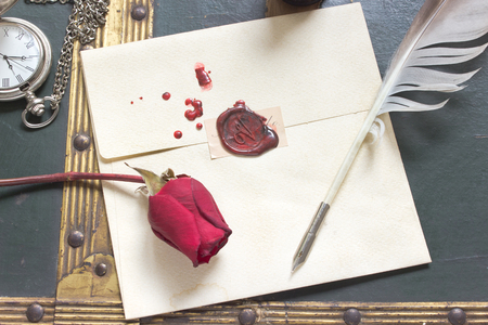 Wax sealed love letter with rose and quill on vintage background