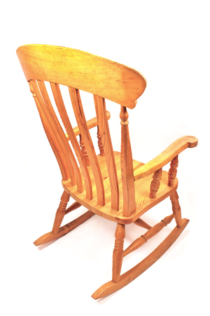 Wooden rocking chair isolated on white