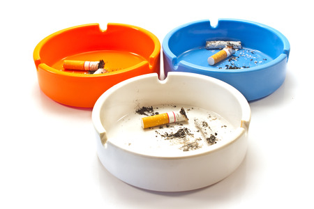 Cigarette butts in ashtray isolated on white 스톡 콘텐츠