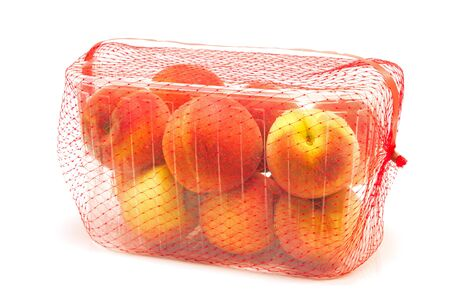 Peaches packaged for sale isolated on white