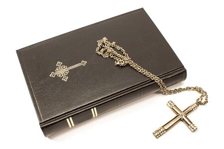 Holy bible with silver cross isolated on white background Stock Photo