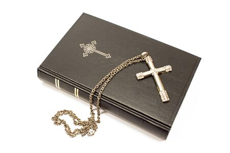 Holy bible with silver cross isolated on white background Imagens