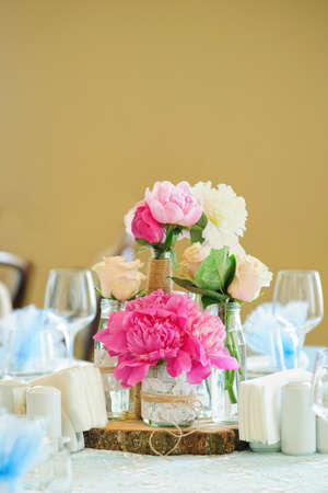 cupping glass cupping: Flower composition with pink peonies and cream roses