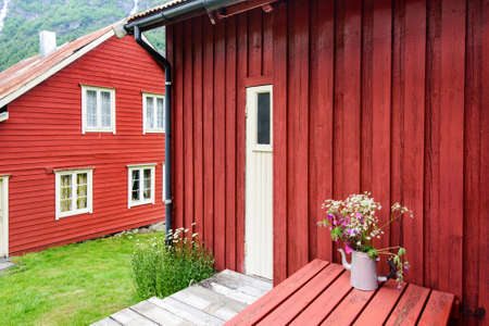 rorbuer: Norwegian wooden red houses in the mountains. Rorbuer on Lofoten Europe Stock Photo