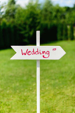arrow sign: White wedding wooden arrow sign on nature background