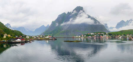 rorbu: Scenic view of Reine - fishing village with red houses in the morning. Beauty of Rorbu, Lofoten islands, Norway