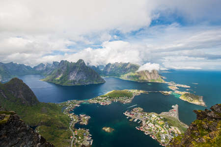 rorbuer: Scenic landscape of Lofoten mountains  and islands in white clouds. Reine village, rorbu, reinbringen Stock Photo