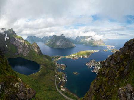 rorbu: Scenic landscape of Lofoten mountains  and islands in white clouds. Reine village, rorbu, reinbringen Stock Photo