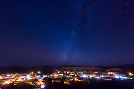 Night view from Ait Ben Haddou, Atlas mountains, Africa. Starry night sky.