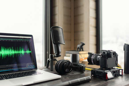 Audio / Video editing workspace office with mountain view. Photography and videography equipment. 免版税图像