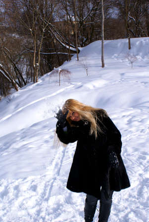 fine blonde play snowball fight clear frosty day photo