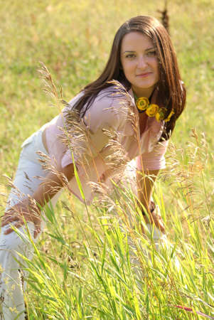 happy young women nice smiling upon summer green meadow photo