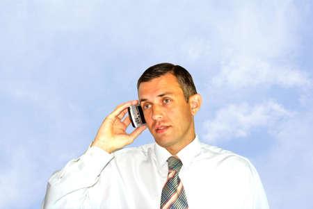 careerist: portrait successful adult businessman speak mobile phone Stock Photo