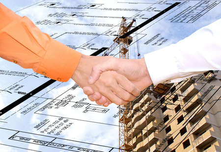 handclasp: association partners in development new energy technology in construction render positive effect upon economic sector Stock Photo