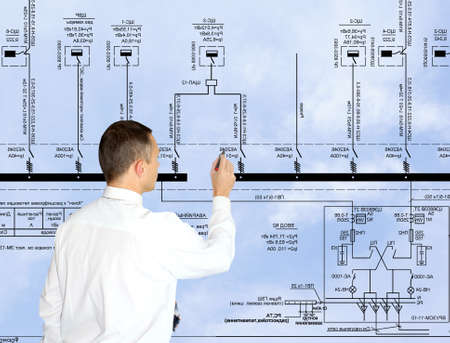 electrical engineer: professional engineer designer admiring size generate electric fundamental scheme Stock Photo