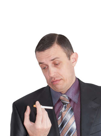 nicotinic: The adult man reflects on harm of smoking and nicotinic dependence Stock Photo