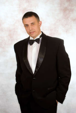 smocking: Portrait the man in a classical tuxedo on an abstract background