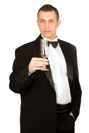 smocking: The imposing man in a classical tuxedo with a wine glass Stock Photo