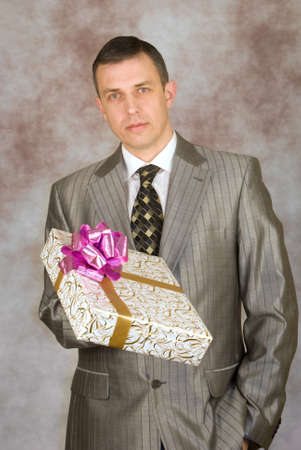 The man likes to give gifts for a holiday Stock Photo - 8838262
