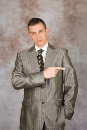 Portrait of the successful businessman on an abstract background Stock Photo - 8838261