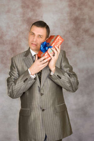 The man is glad to a pleasant surprise in the birthday Stock Photo - 8838263