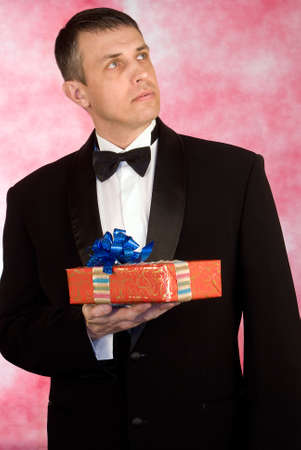 smocking: The man likes to give gifts for a holiday Stock Photo