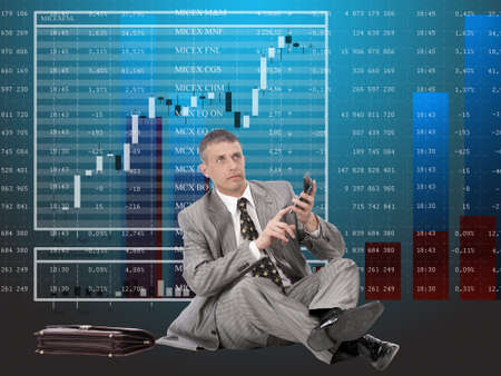 considers: The successful businessman considers financial profit on financial investments Stock Photo