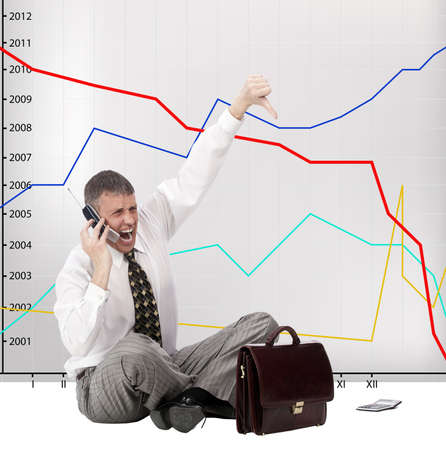 The businessman angry falling of exchange indexes phones in company office Stock Photo - 9605566