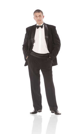 The elegant man in a classical tuxedo on a white background Stock Photo - 12454231