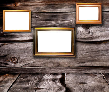 Decorative frames for a photo  on a old wooden background photo