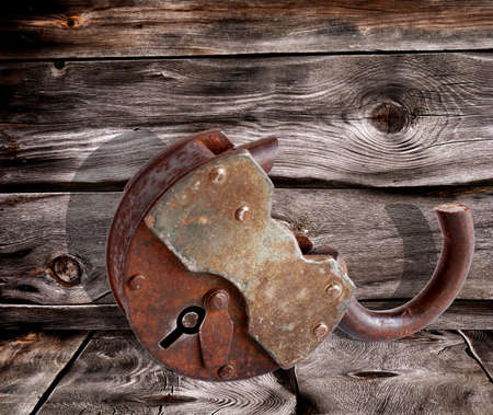 doorlock: The rusty old door-lock over dark boards background