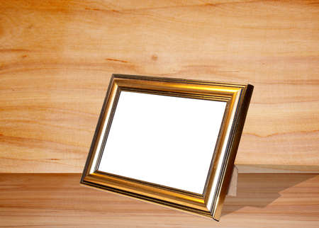 Decorative frame for a photo  on a light wooden background photo
