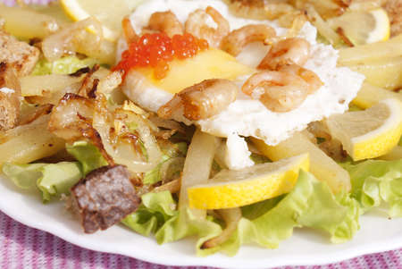 Creative salad from fresh seafood and cheese with leaves of lettuce photo