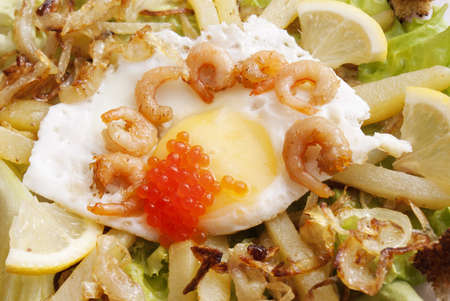 Creative fresh salad from seafood and fried eggs photo