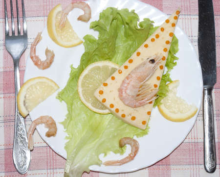 Creative fresh salad from seafood and fresh vegetables photo