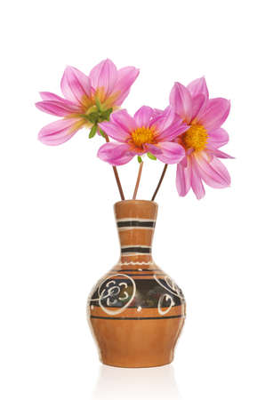 The vintage antique vase and bouquet pink decorative flower photo