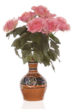 The vintage antique vase and bouquet decorative rose photo